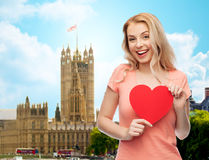 Happy woman or teen girl with red heart shape Royalty Free Stock Image