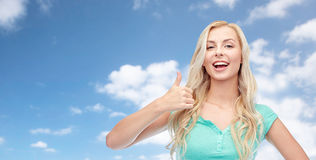 Happy woman or teenage girl showing thumbs up Royalty Free Stock Photos