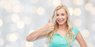 Happy woman or teenage girl showing thumbs up Royalty Free Stock Photography