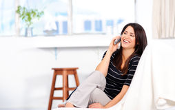 Happy woman on telephone Stock Image