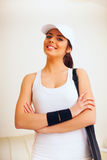 Happy woman with tennis bag Royalty Free Stock Images