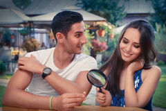 Happy Woman Testing Engagement Ring from Boyfriend with Magnifier Stock Image
