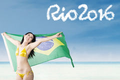 Happy woman with text of Rio 2016 Stock Photo