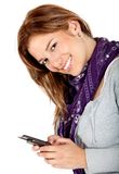 Happy woman texting on her phone Royalty Free Stock Photo