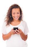 Happy woman texting on her phone Stock Photography