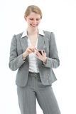 Happy woman texting on mobile Royalty Free Stock Photography