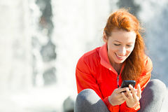 Happy Woman Texting on Phone Royalty Free Stock Photos