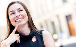 Happy woman thinking Royalty Free Stock Image