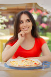 Happy Woman Thinking About Eating Pizza on a Diet Royalty Free Stock Photo