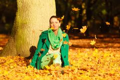 Happy woman throwing autumn leaves in park Royalty Free Stock Image