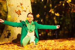 Happy woman throwing autumn leaves in park Royalty Free Stock Photography