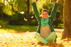 Happy woman throwing autumn leaves in park Stock Photography