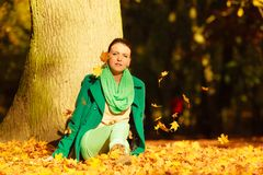 Happy woman throwing autumn leaves in park Stock Image