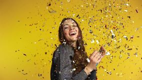 Happy woman throwing confetti enjoying party. Celebration and event concept. Slow motion stock video footage