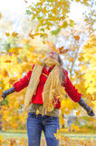 Happy woman throwing leaves Stock Photo