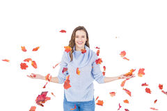 Happy woman throwing leaves Royalty Free Stock Image