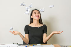 Happy woman throwing papers at work royalty free stock image