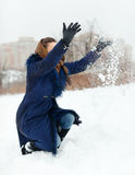 Happy woman throwing snow Royalty Free Stock Photography