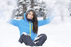 Happy woman throwing snow in the air Royalty Free Stock Image
