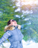 Happy woman throwing snow Stock Photos