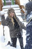 Happy woman throwing snowball. Having fun, smiling Stock Photos