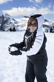 Happy Woman throwing Snowball Mountain Vacation Royalty Free Stock Images