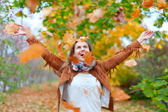 Happy woman throws  leaves Royalty Free Stock Photo