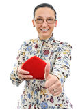 Happy woman with thumb up and gift box Stock Photos