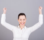 Happy woman with thumbs up. Winning success woman happy ecstatic celebrating being a winner. Dynamic energetic image of a  female model  on white background Stock Photo