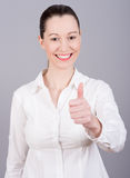 Happy woman with thumbs up. Winning success woman happy ecstatic celebrating being a winner. Dynamic energetic image of a  female model  on white background Stock Photos