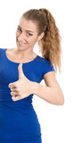 Happy woman with thumbs up - isolated over a white background. Royalty Free Stock Photography