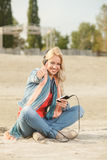 Happy woman with thumbs up listening to music with headphones Stock Photos