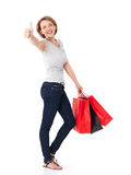 Happy woman with thumbs up sign after shopping Royalty Free Stock Photo
