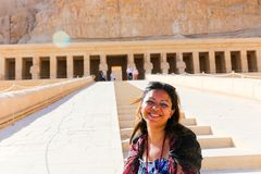 Happy woman at Thutmose Temple - Luxor, Egypt. El Der El Bahary or Hatshepsut Temple - Luxor, Egypt 20 September 2017 Statues Stock Photos