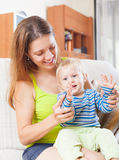 Happy woman with toddler on sofa Stock Photo