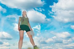 Happy woman on the top of a mountain. With blue sky and clouds Stock Photo