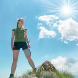 Happy woman on the top of a mountain. At sunset Stock Photo