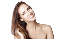 Happy woman touching hair Royalty Free Stock Images