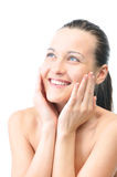 Happy woman is touching her face Royalty Free Stock Photo