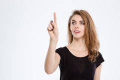 Happy woman touching invisible screen Stock Photos