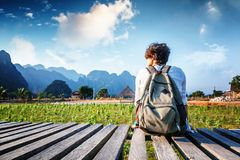 Happy woman tourist admires the scenery of hills and fields. Tra Royalty Free Stock Photography