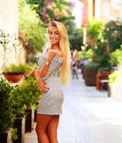 Happy woman tourist on background of blooming street Royalty Free Stock Photos