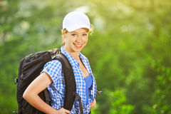 Happy woman tourist with a backpack Stock Images