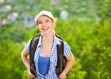 Happy woman tourist with a backpack Royalty Free Stock Images