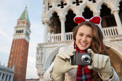 Happy woman tourist with camera on Christmas in Venice, Italy Royalty Free Stock Photos