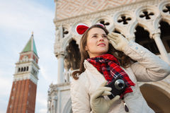 Happy woman tourist with camera on Christmas in Venice, Italy Stock Images