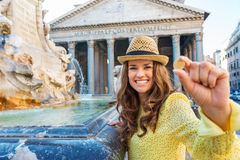 Happy woman tourist holding coin to throw in Pantheon fountain Royalty Free Stock Photos