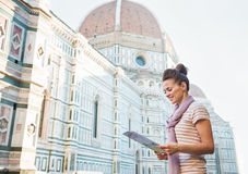 Happy woman tourist looking at the map in Florence, Italy Stock Image