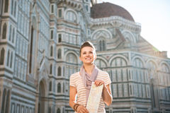 Happy woman tourist with map standing in front of Duomo, Italy Royalty Free Stock Photography
