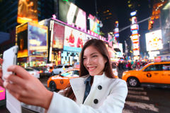 Happy woman tourist in New York, Times Square. Happy woman tourist taking photo picture with tablet in New York City, Manhattan, Times Square. Girl traveler Stock Photography